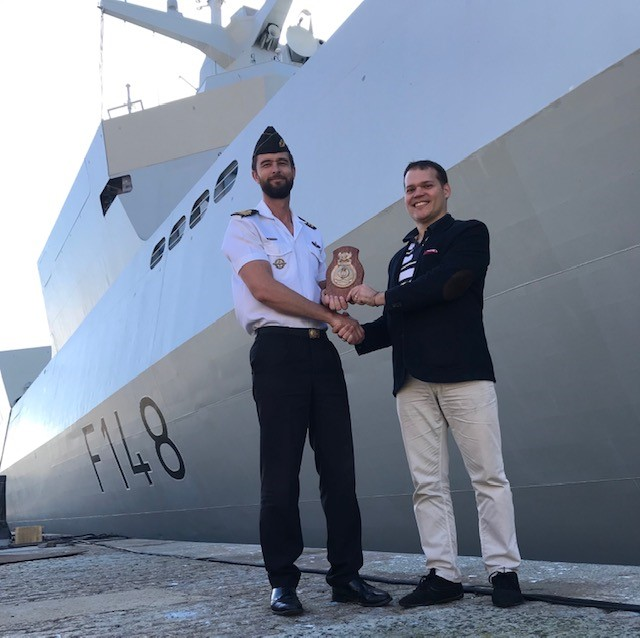 Honour - Commander Leon van Zyl presenting Claudio Chiste with the Ship